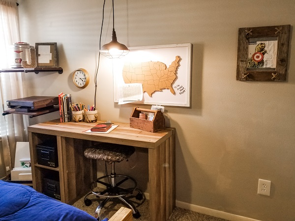 """A """"shot"""" of desk organization was created in this hunting themed room with fake ammo boxes made with metal boxes, stencils and paint."""