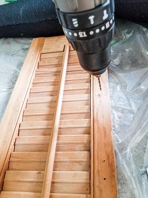 DIY project turning a shutter into a mug rack
