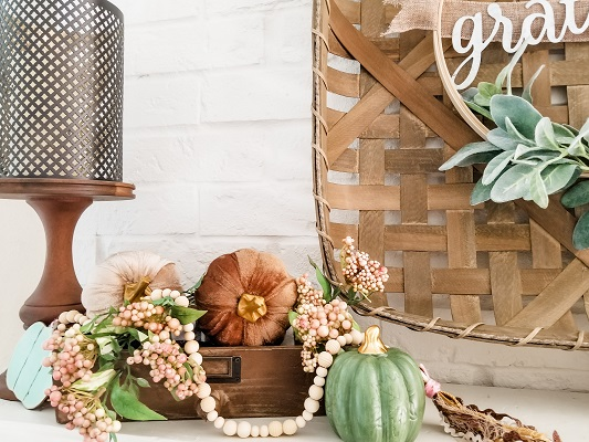 A farmhouse fall mantel with DIY projects and dollar tree pumpkins