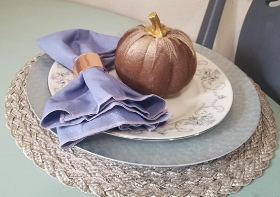 A Thanksgiving place setting with a mix of Dollar tree finds and china plates