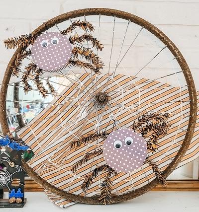 A Bike Wheel Rim Gets New Life As A Web On This Halloween Mantel